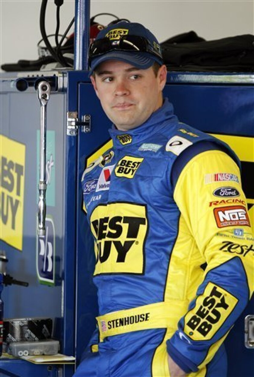 Ricky Stenhouse Jr. waits in his garage during practice for the NASCAR Daytona 500 Sprint Cup Series auto race at Daytona International Speedway, Wednesday, Feb. 20, 2013, in Daytona Beach, Fla. (AP Photo/Terry Renna)