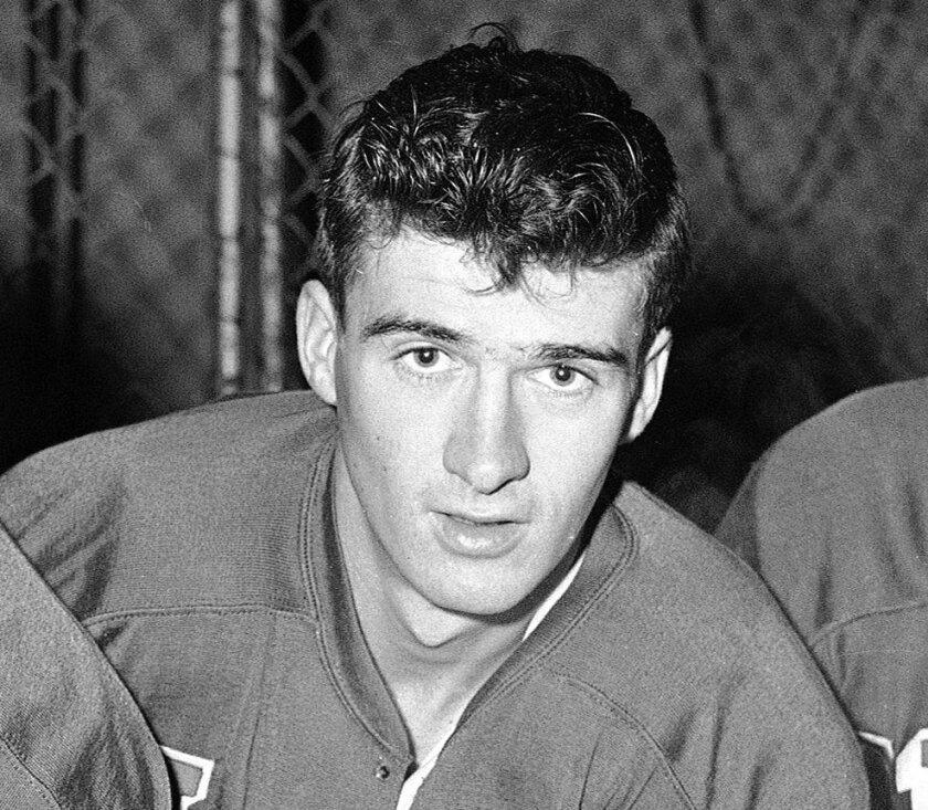 FILE - This is a Jan. 6, 1960, file photo showing U.S. Olympic hockey player Bill Christian. Father and son Bill Christian and Dave Christian have put their Olympic gold medals, among many other items, up for auction this month. The memorabilia is valuable, but the memories can't be bought or sold.