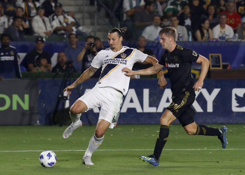 CARSON, CALIF. - AUG. 24, 2018. Galaxy forward Zlatan Ibrahimovic tries to get the ball inside against LAFC defender Walker Zimmerman in the second half Friday, Aug. 24, 2018, at StubHub Center in Carson. (Luis Sinco/Los Angeles Times)