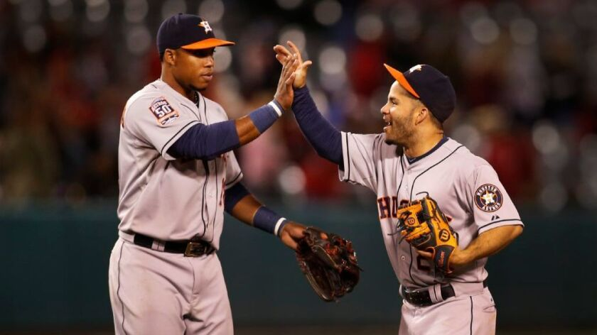 Luis Valbuena, left, greeting Jose Altuve after a game last season with the Houston Astros, is joining the Angels on a two-year deal.