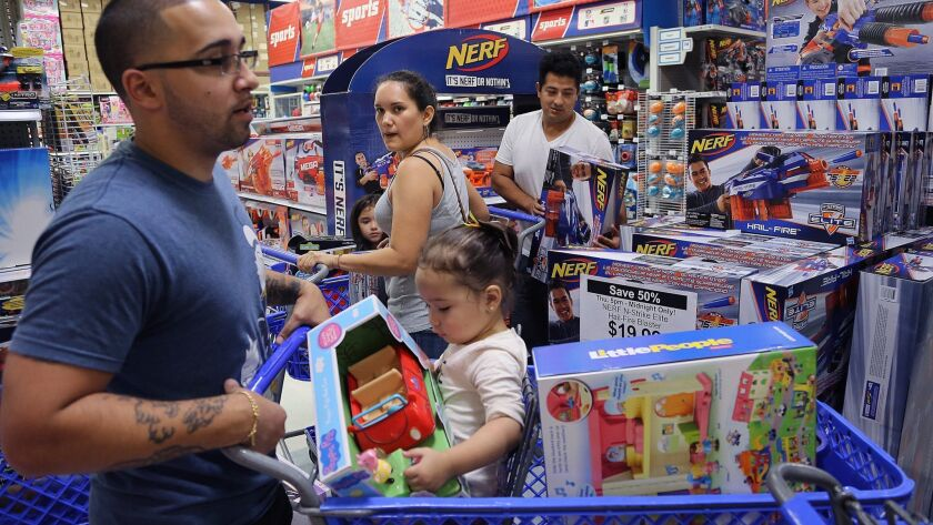 "Shopper scramble for Black Friday deals at a Toys ""R"" Us in Doral, Fla."