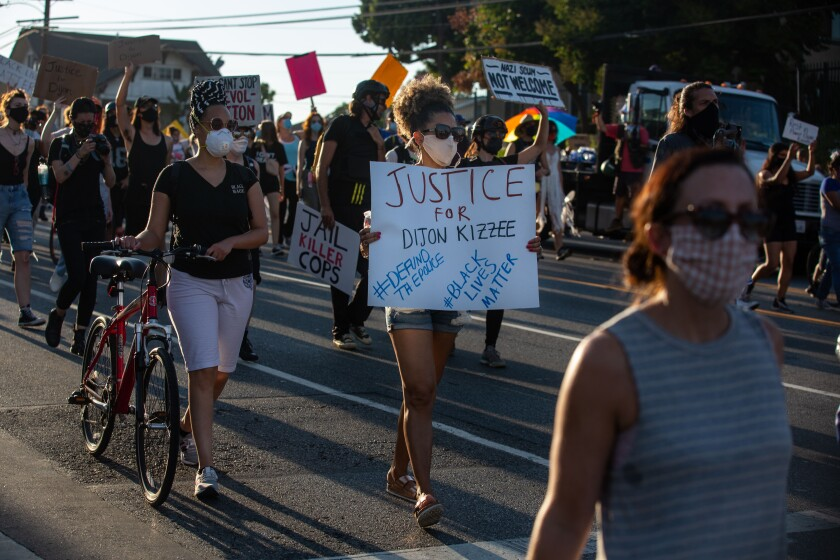 Protesters march in front of the South Los Angeles Sheriff's station to demand justice for Dijon Kizzee.