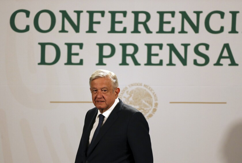 FILE - In this April 20, 2021 file photo, Mexican President Andres Manuel Lopez Obrador arrives to give his daily, morning news conference at the presidential palace in Mexico City. Lopez Obrador said on Aug. 5, 2021 that Mexico has accepted to host talks between representatives of the Venezuelan government and its opposition, with Norway as the mediator. (AP Photo/Fernando Llano, File)
