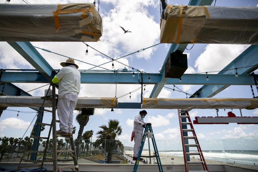 Workers paint and make other renovations to Cannonball at Belmont Park.