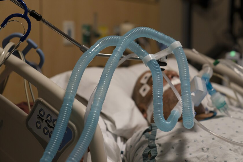 FILE - In this Nov. 19, 2020, file photo, ventilator tubes are attached to a COVID-19 patient at Providence Holy Cross Medical Center in the Mission Hills section of Los Angeles. U.S. deaths from COVID-19 are falling again as the nation recovers from the devastating winter surge. (AP Photo/Jae C. Hong, File)