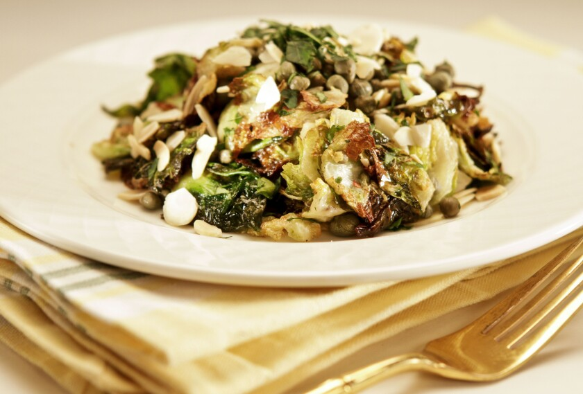 A salad made with deep-fried Brussels sprout leaves by Cleo restaurant. Recipe