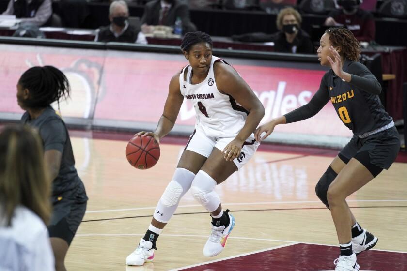 South Carolina forward Aliyah Boston (4) works against Missouri forward LaDazhia Williams (0) during the first half of an NCAA college basketball game Thursday, Feb. 11, 2021, in Columbia, S.C. (AP Photo/Sean Rayford)