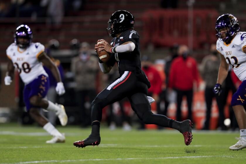Cincinnati quarterback Desmond Ridder carries the ball against East Carolina on Nov. 13, 2020.