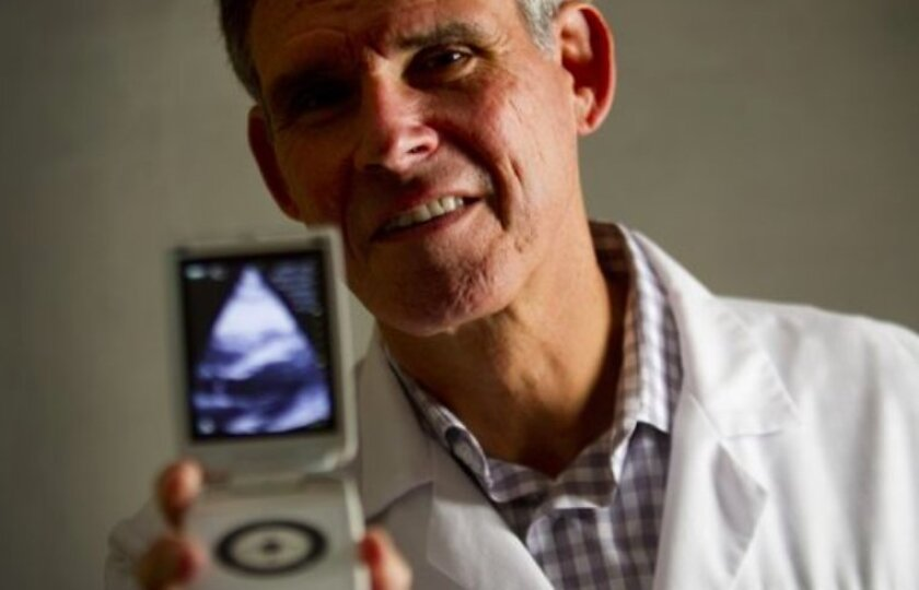 Eric Topol, director of the Scripps Translational Science Institute, holds the Vscan ultrasound.