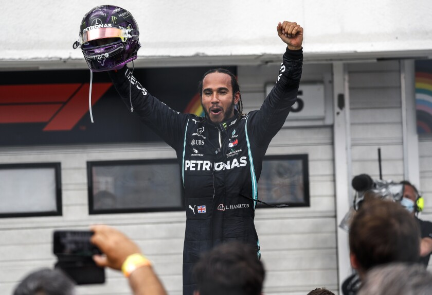 Mercedes driver Lewis Hamilton celebrates after winning the Hungarian Grand Prix.