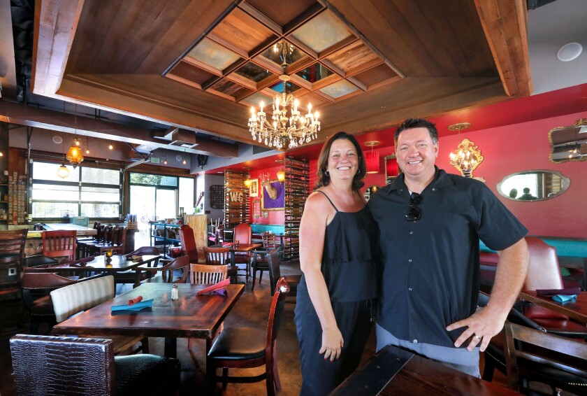 Portrait of Aaron (left) and Roddy Browning, owners of the Flying Pig Pub & Kitchen in their restaurant's dining room.