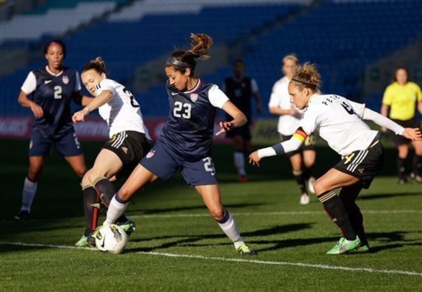 Christen Press, center, of the US, challenges Germany's defense during their Algarve Cup women's soccer final match Wednesday, March 13 2013, at the Algarve stadium outside Faro, southern Portugal. (AP Photo/Armando Franca)