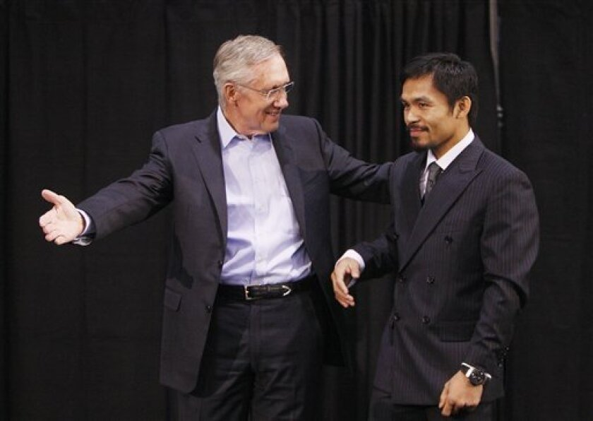 Senate Majority Leader Harry Reid, left, and boxer Manny Pacquiao appear at a rally Friday, Oct. 29, 2010 in Las Vegas. (AP Photo/Isaac Brekken)