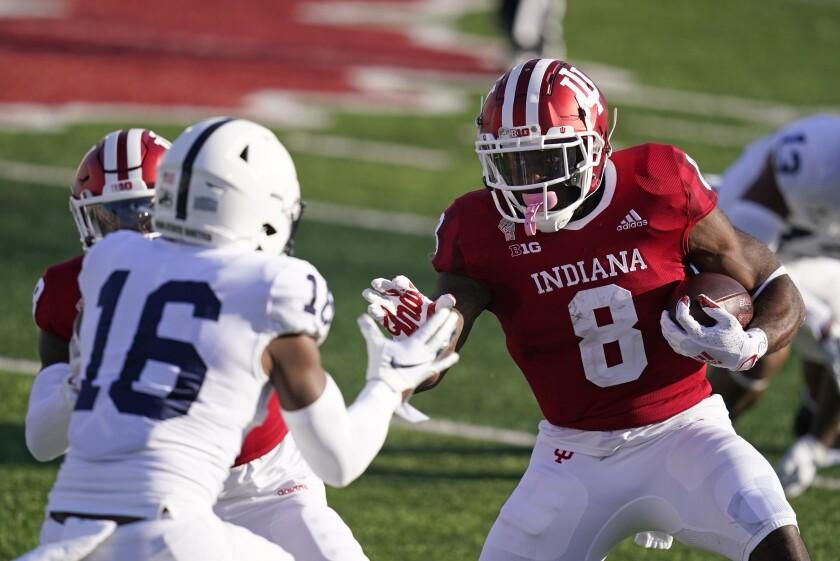 Indiana running back Stevie Scott III runs against Penn State's Ji'Ayir Brown.