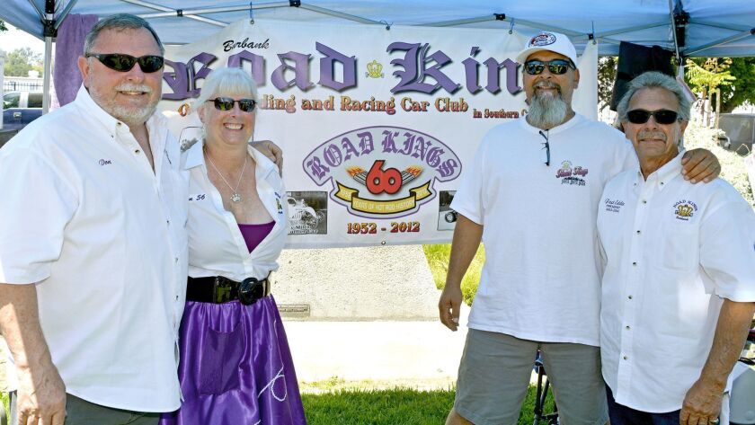 Catching some shade during the heat that blasted last week's car show are longtime Road Kings member