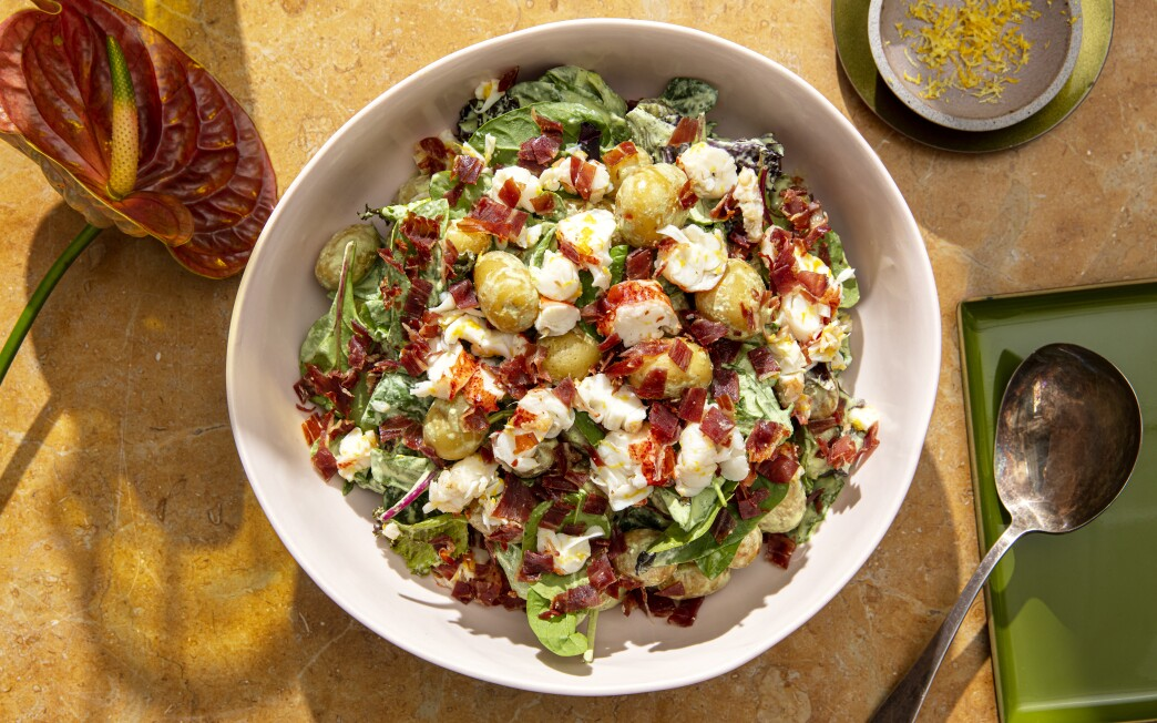 Green goddess dressing dresses this simple potato salad, topped with salty prosciutto and rich, lemony lobster.