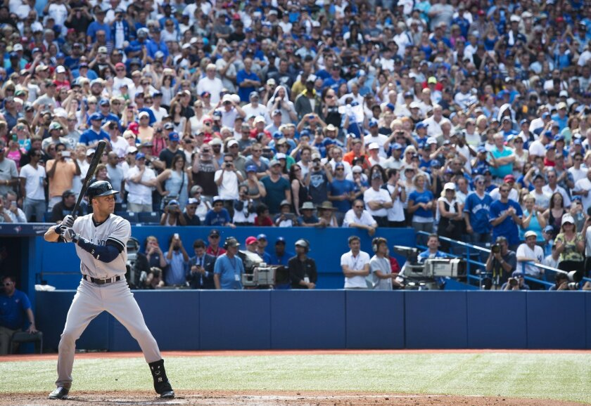 Fans stand on their feet as New York Yankees' Derek Jeter takes his last at-bat at the Rogers Centre during ninth inning MLB baseball action against the Toronto Blue Jays in Toronto on Sunday, Aug.31, 2014. (AP Photo/The Canadian Press, Darren Calabrese)