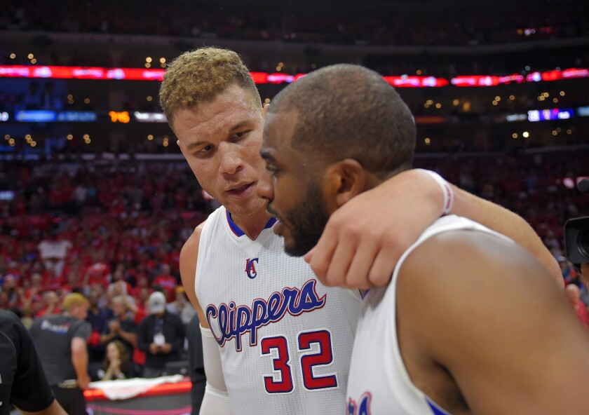 Clippers forward Blake Griffin, left, hugs guard Chris Paul after they defeated the Spurs in a first-round Game 7.