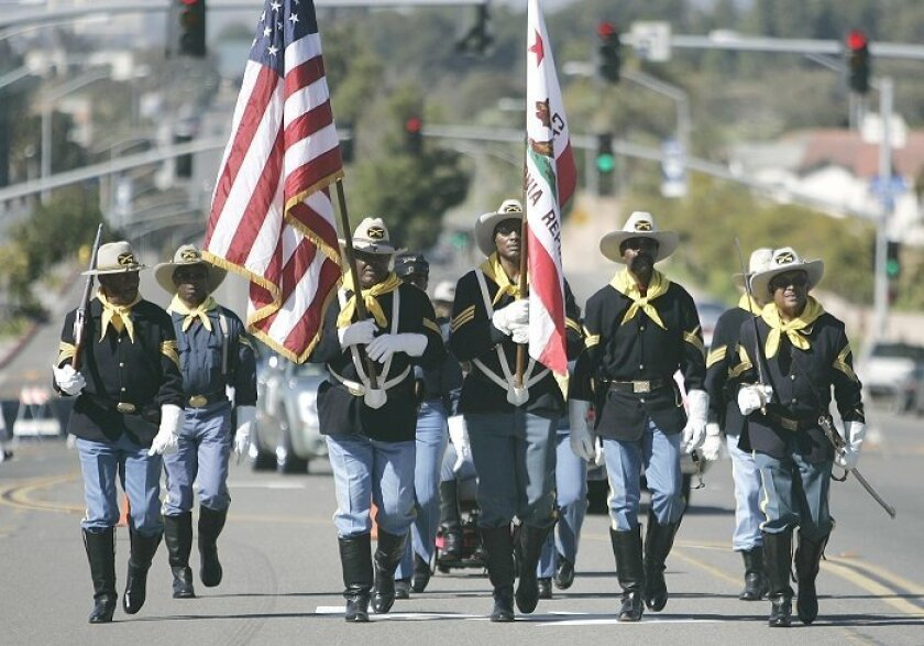 A contingent of Buffalo Soldiers led yesterday's annual Heritage Day  parade along Imperial and Euclid avenues. Attendees shared a sense of what's  possible for the neighborhood, which some say is too often known only for its  violence.