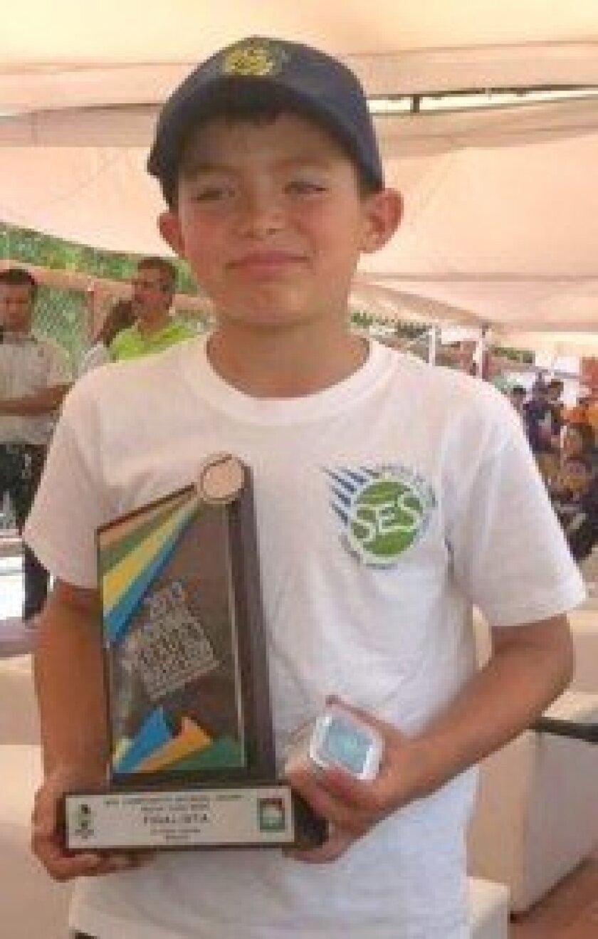 SES Tennis Center student and rising youth tennis champion Eugenio Gonazlez.