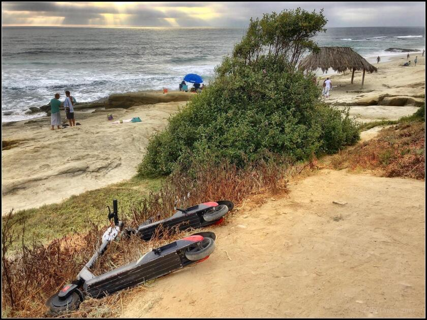 "This shows the Windansea Beach scooter abuse I observed on Aug. 5, 2019 in La Jolla. The ""Adopt a Beach"" slogan seems to have been co-opted by scooter pollution. — Cliff Oliver"
