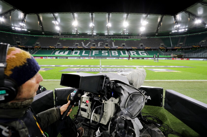 A television cameraman prepares to broadcast a UEFA Europa League match between Wolfsberg and Shakhtar Donetsk on Thursday.