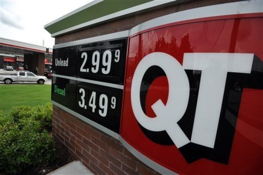 FILE - In this Monday, July 1, 2013 photo, a sign advertising unleaded gas for $2.99 is seen at a QuikTrip station in Greenville, S.C. Gasoline prices are on a summer slide, giving U.S. drivers a break as they set out for the beach and other vacation spots for the Fourth of July. (AP Photo/Rainier Ehrhardt, File)