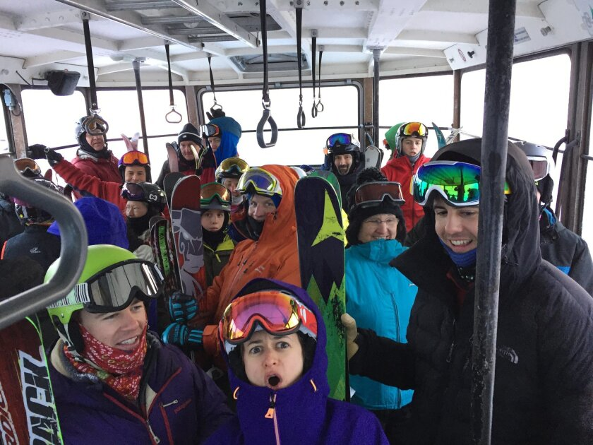 People stand in a tram car Sunday, Feb. 14, 2016, after it became stuck 40 feet off the ground in sub-zero temperatures at Cannon Mountain Aerial Tramway in Franconia, N.H. Crews have rescued 48 people from two tram cars at the New Hampshire ski resort after it became stuck. A Cannon Mountain spoke
