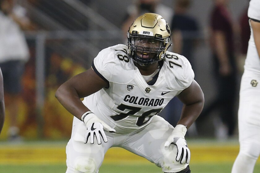 FILE- In this Sept. 21, 2019, file photo, Colorado offensive lineman William Sherman (78) gets set at the line during the first half of an NCAA college football game against Arizona State in Tempe, Ariz. The scouts were there in big numbers. But NFL prospects who were timed and tested, poked and prodded at the pro days didn't have the usual contingent of underclassmen looking on and offering their support. (AP Photo/Rick Scuteri, File)