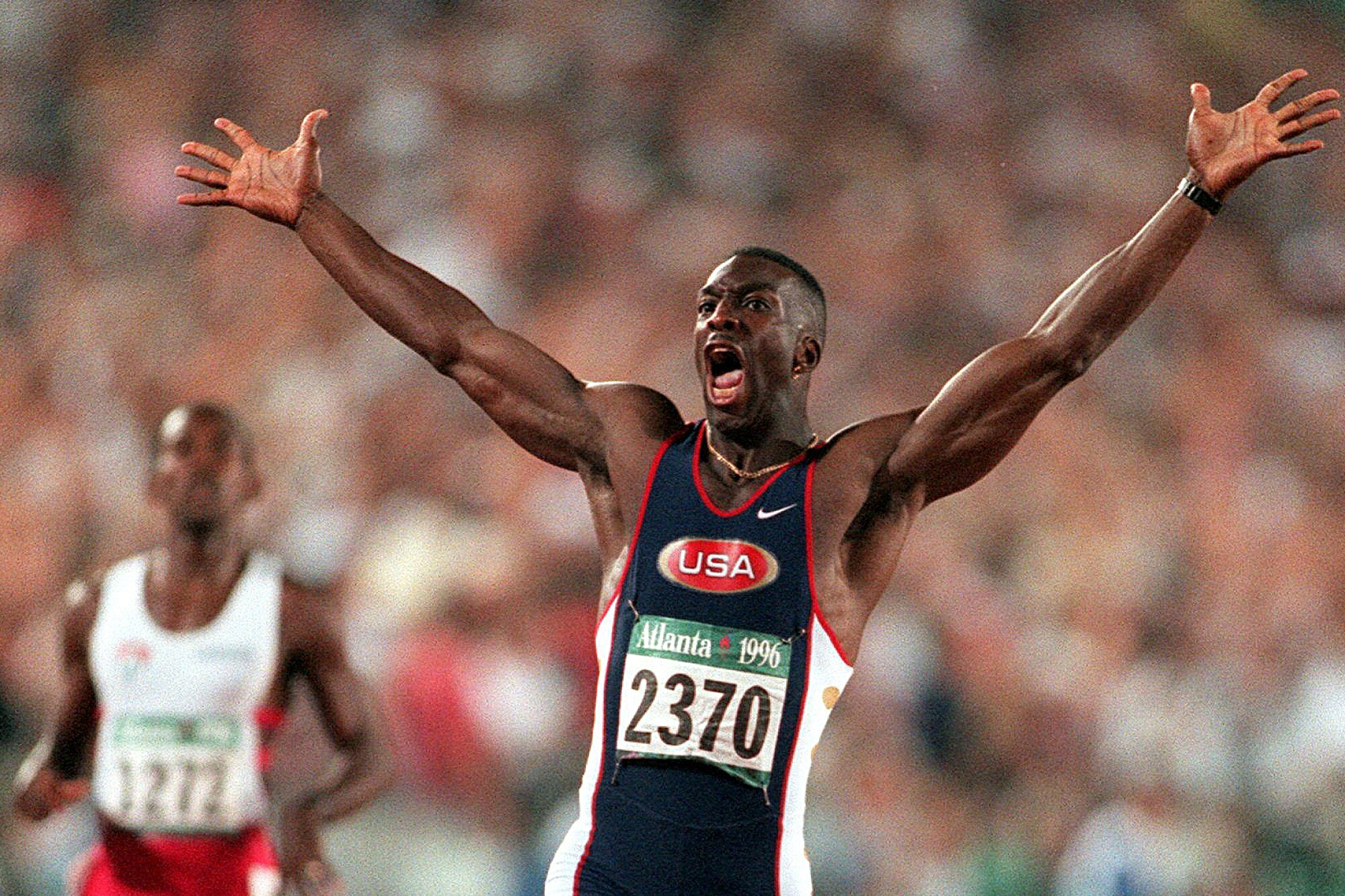Michael Johnson celebrates after he won the men's 200 meter final in 1996.