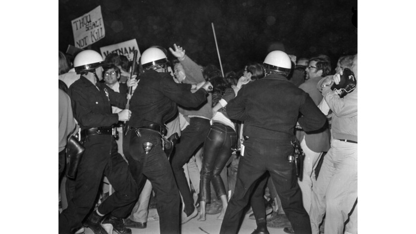 June 23, 1967: Police push vigorously into massed demonstrators along the Avenue of the Stars in a