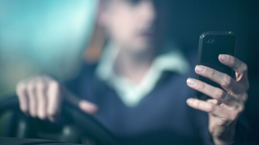 Man using smartphone whilst driving