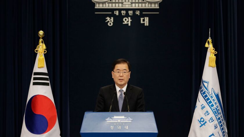 South Korean delegation head Chung Eui-yong speaks to the media at the presidential Blue House in Seoul, South Korea, Tuesday, after returning from North Korea.