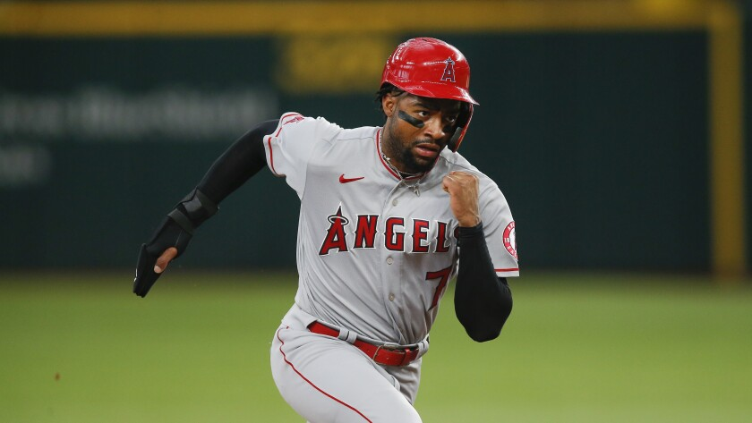 Angels' Jo Adell (7) runs to third during a baseball game against the Texas Rangers