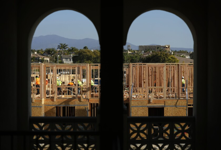 Framers work at the Enclave Otay Ranch Apartments in Chula Vista on Jan.13, 2020.