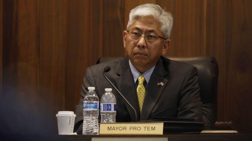 Los Alamitos, CA April 16, 2018: Warren Kusumoto Los Alamitos Mayor Pro Tem listens to public com