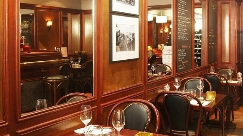 The decor of Le Petit Bistrot mirrors the relaxed ambiance of a classic Parisian brasserie.