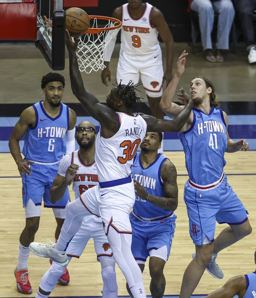 New York Knicks forward Julius Randle (30) shoots the ball as Houston Rockets forward Kelly Olynyk (41) defends during the first quarter of an NBA basketball game in Houston, Sunday, May 2, 2021. (Troy Taormina/Pool Photo via AP)