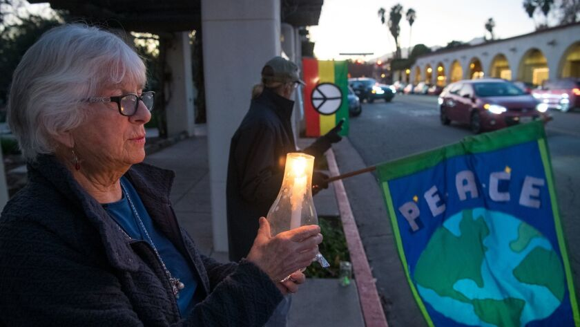 OJAI, CA - JANUARY 18, 2019: Marqui Bury holds a candle at a weekly Friday night peace vigil along O