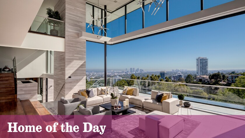 Walls of windows and glass doors take in views of the downtown cityscape at this $19.95-million contemporary-style home in Hollywood Hills West.