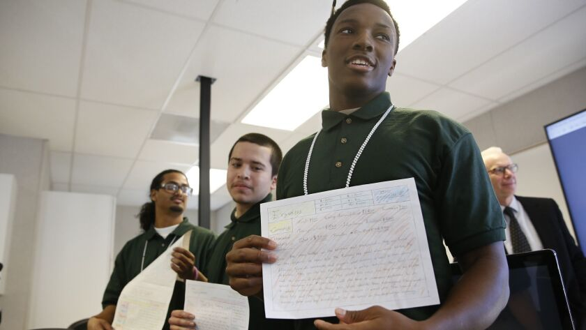 Derrick McDougal, right, a youthful offender at the O.H. Close Youth Correctional Facility, displays