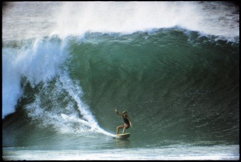 WindanSea Surf Club member Mike Hynson takes on the Banzai Pipeline in the early '70s. The Hawaiian surf break is located off Ehukai Beach Park in Pupukea on Oahu's North Shore. Jeff Divine