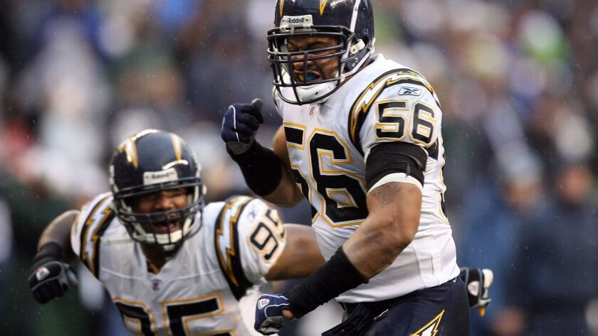 Linebackers Shawne Merriman (56) and Shaun Phillips (95) were two defensive stalwarts on the 2006 Chargers team that went 14-2 in the regular season.