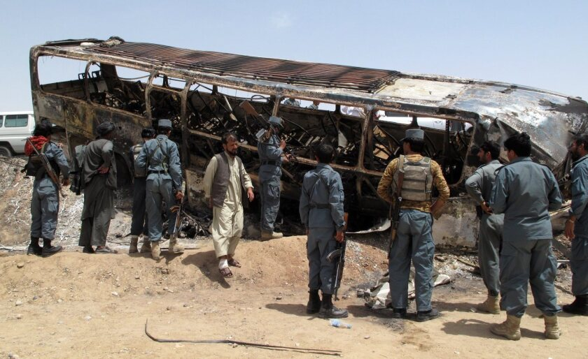 Six Afghan policemen poisoned, shot to death; seventh is missing