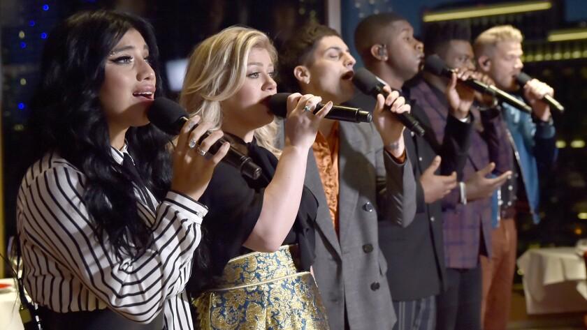 "Kirstin Maldonado, left, Kelly Clarkson, Mitch Grassi, Matt Sallee, Kevin Olusola, Scott Hoying in ""Pentatonix: A Not So Silent Night"" on NBC."