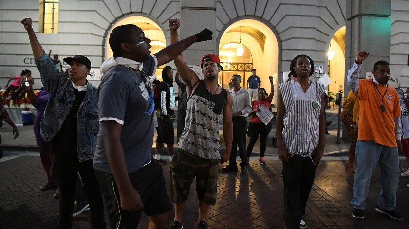 Protesters supporting the Black Lives Matter movement chant outside L.A. City Hall on Thursday as they occupy space near the entrance on South Main Street.