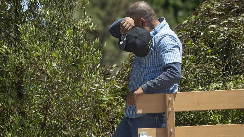 CANOGA PARK, CA-JULY 11, 2019: Salvador Betancurt wipes away the sweat while unloading dodonea purp