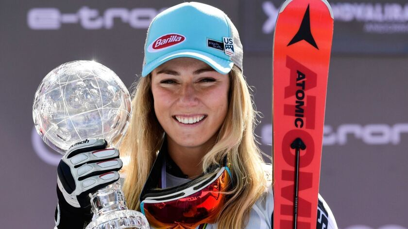 American skier Mikaela Shiffrin poses on the podium with the crystal globe trophy after winning the World Cup Finals slalom race on Saturday.