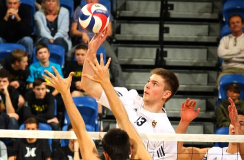 UC Irvine's Collin Mehring guides a shot past the block of Pepperdine defenders in a Mountain Pacific Sports Federation match this season.