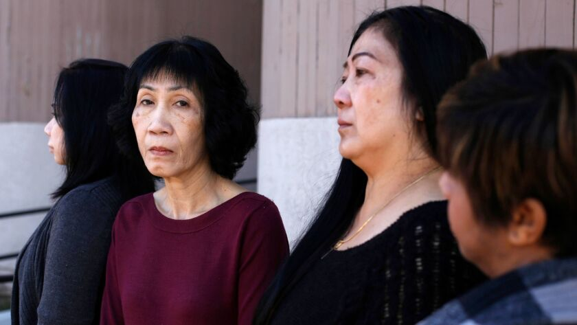Tuyet Mai Nguyen, left, Trinh Truong, Thu Hang Pham and Jenny Hoang are suing the owners of Tustin Nailspa in Orange, alleging that they were forced to work overtime but paid for only eight hours.